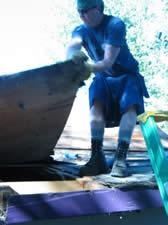 Adam Bogle ripping the roof of his garage in his denim work kilt
